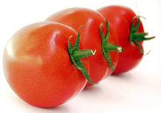 Three tomatoes. Tomatoes after diagonal about left to right Royalty Free Stock Images