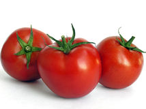 Three tomatoes. Red shapely tomatoes Stock Image