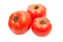 Three tomatoes. Three ripe tomatoes on white background closeup Stock Photography