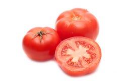 Three  tomatoes Stock Photography