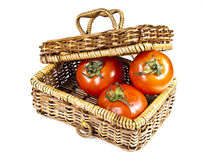 Three tomatoes in basket with lid. On white background Stock Photography