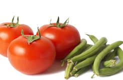 Three tomatoes and beans isolated on white Royalty Free Stock Photo