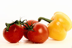Three Tomatoes And An Intruder Stock Photo