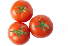 Three tomatoes isolated on white Stock Images
