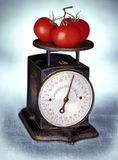 Three tomatoes on old scale Royalty Free Stock Photo