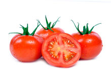 Three tomatoes and one half Royalty Free Stock Photos