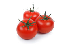 Three tomatoes over white. stock images