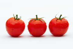 Three tomatoes side by side Stock Image
