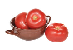 Three tomatoes  in a vase Royalty Free Stock Images