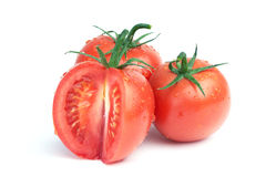 Three tomatoes with water drops Royalty Free Stock Photo