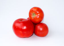 Three tomatoes on a white background.  Stock Photography