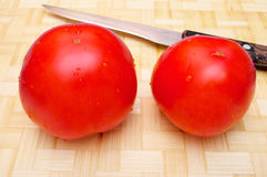 Three tomatos Stock Images