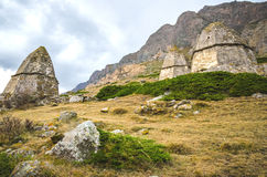 Three tomb on the background of a high mountain. In Kabardino-Balkaria Royalty Free Stock Photo