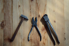 Three tools on a wooden background Royalty Free Stock Photography