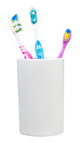 Three tooth brushes in ceramic glass Royalty Free Stock Photography