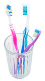Three tooth brushes in glass Royalty Free Stock Photos