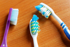Three toothbrushes closeup Stock Images