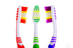 Three toothbrushes that are in discussions. Three toothbrush set isolated on white background stock photo