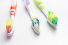 Three Toothbrushes on a shelf. Royalty Free Stock Photos