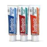 Three toothpaste containers Stock Image