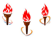 Three torches with fire flames Stock Images