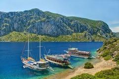 Three tourist boats moored at island Royalty Free Stock Photo