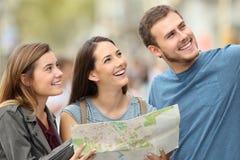 Three tourists enjoying vacations Stock Photo