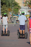 Three tourists on a Segway in Nice, France Royalty Free Stock Photos