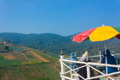 Three Tourists Sit On Viewpoint Of Phu Thap Boek --- Tourist Attraction In Petchabun, Thailand stock photography