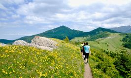 Three tourists in the Slovak mountains Stock Photos