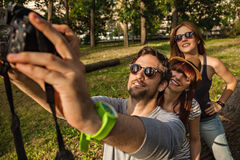 Three Tourists Taking Selfie Royalty Free Stock Photography