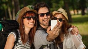 Three Tourists Taking Selfie Royalty Free Stock Photos