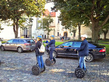 Three tourists travel Prague on segways Stock Photography