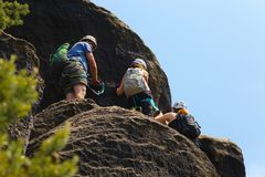 Three tourists on via ferrata. View up to three tourists on via ferrata Royalty Free Stock Photo