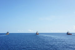 Three tow boats to move drilling rig. Rig move operation Royalty Free Stock Images