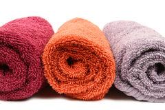 Three Towels. Three colorful towel rolls on white background Stock Images