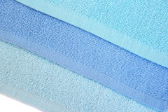 Three towels. Three blue  towels on white background Royalty Free Stock Photos