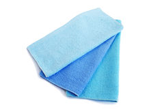 Three towels. Three blue  towels isolated on white background Royalty Free Stock Image