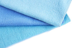 Three towels. Three blue  towels isolated on white background Royalty Free Stock Photo