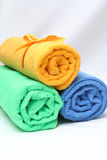 Three towels curtailed into tubules. Blue, green, yellow Stock Image