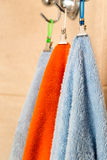 Three towels hanging on a hook Royalty Free Stock Photography