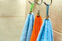 Three towels hanging on a hook Royalty Free Stock Image
