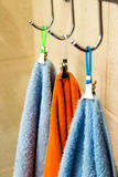Three towels hanging on a hook Stock Images