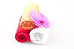 Three towels with orchidaceae Royalty Free Stock Photography