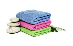 Three towels and three stones Royalty Free Stock Photo