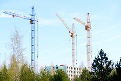 Three tower cranes at a construction site stock photos