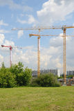 Three tower cranes on construction site Stock Photography