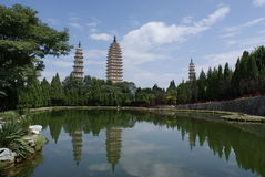 The three-tower temple. Three towers is reflected in the lake of the  three-tower temple Royalty Free Stock Photography
