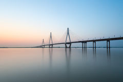 Three towers of cable-stayed bridge. Cable stayed bridge on the lake at dusk stock image