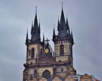 Three towers of the castle voyeurs over the roofs of houses in Prague. stock images